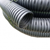 "4""X100' PERF. ADT PIPE / ROLL   